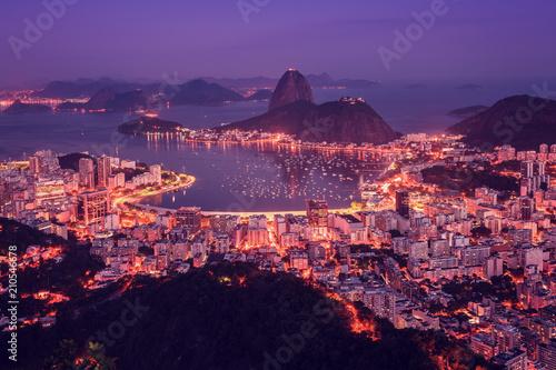 Rio de Janeiro skyline panorama at sunsey, Brazil. Sugarloaf Mountain and Botafogo Bay