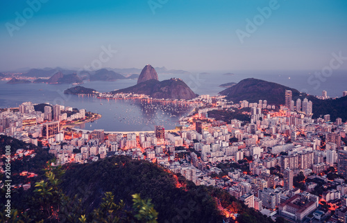 Sugarloaf Mountain at sunset with skyline of Rio de Janeiro, Brazil