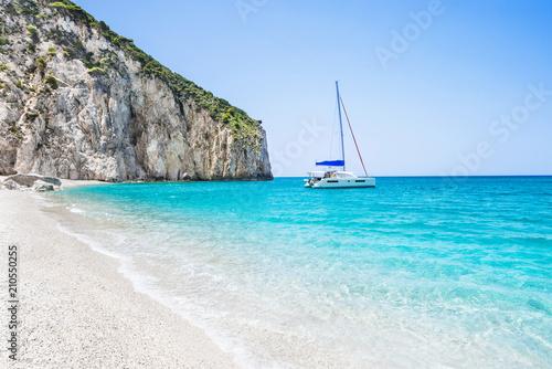 Fotografie, Obraz Beautiful lagoon with sailing boat and beach, Lefkada island, Greece