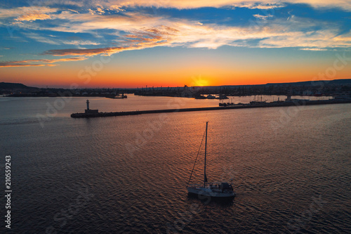 Keuken foto achterwand Diepbruine Aerial view of lighthouse and sail boat at sunset in Varna, Bulgaria.