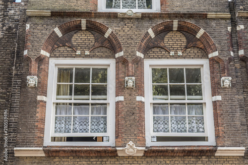 Traditional Dutch White Lace Curtains Behind Two Ancient Windows