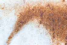 A Close-up Of Rust On A White Metal Plate. Abstract Background Texture