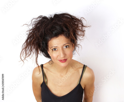 Fotografie, Obraz  Disheveled  attractive young woman portrait on white background