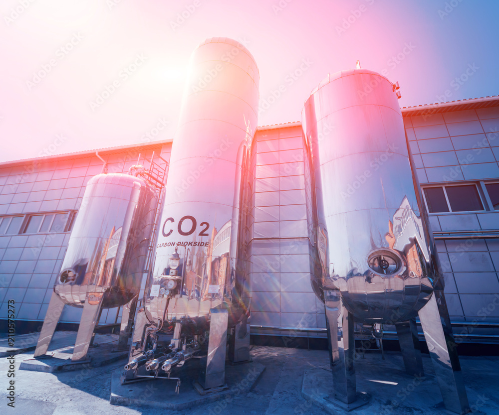 Fototapeta The tank with water, carbon and ladder. Equipment for beverages factory.
