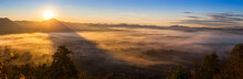 Sunrise On Top Of Mountain With Foggy And Clear Sky