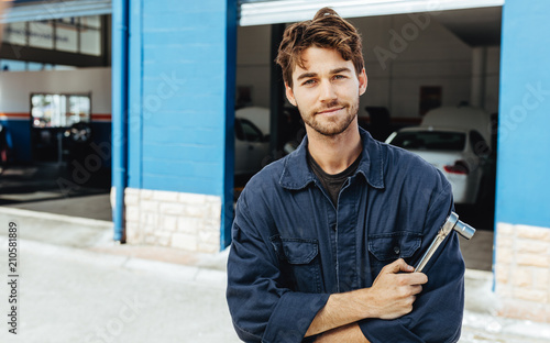 plakat Confident young car mechanic