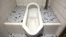 JAPANESE OLD STYLE SQUAT TOILET.