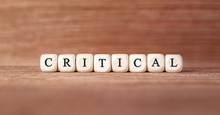 Word CRITICAL Made With Wood Building Blocks