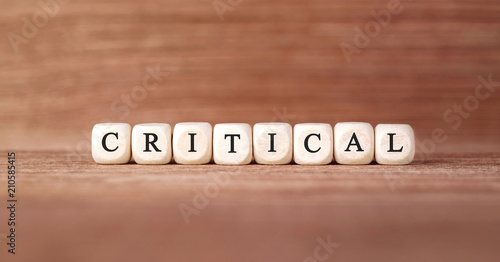 Valokuva  Word CRITICAL made with wood building blocks