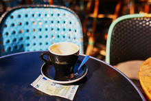 Cup Of Black Coffee On A Table Of Outdoor Cafe