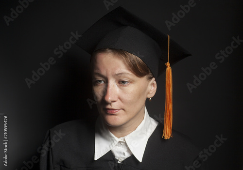 Fotografija  Portrait of Female bachelor in Black mantle and Graduation Cap