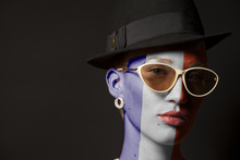 Portrait Of Woman With Painted France Flag And Sunglasses