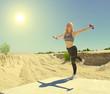 Sporty girl doing swallow exercises in the desert. Sun is shining.