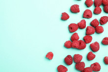 Flat Lay Composition With Ripe Aromatic Raspberries On Color Background