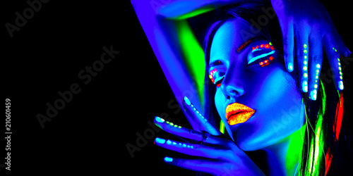 Fashion model woman in neon light, portrait of beautiful model girl with fluorescent makeup, Body art design in UV, painted face, colorful make up, over black background