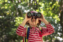 Little Girl Using Binoculars I...