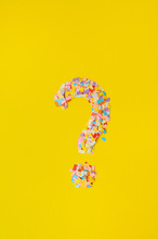 Question Mark On A  Background From Multi-colored Confetti, From Pieces Of Color Paper.