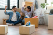 Asian young couple are glad after successfull packing the big cardboard box for moving in new house, Moving and House Hunting concept,