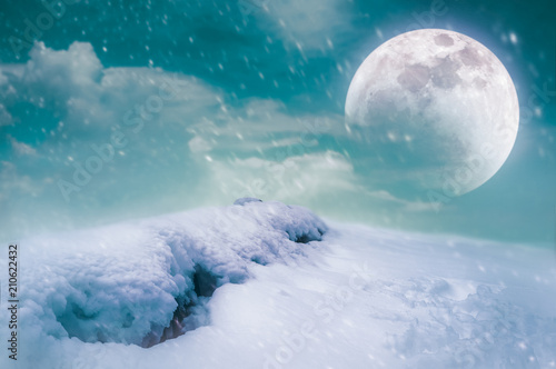 Tuinposter Groen blauw Landscape at snowfall with super moon. Serenity nature background.