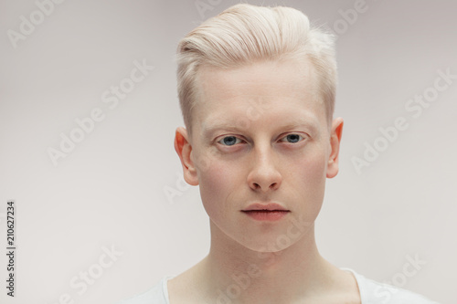 Fashion albino model man portrait isolated on white background Wallpaper Mural