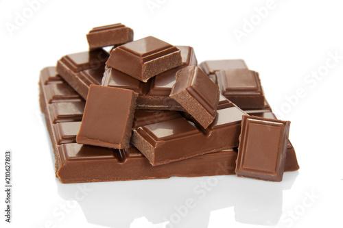 Foto op Aluminium Snoepjes Lots tasty of pieces of broken milk chocolate isolated on white