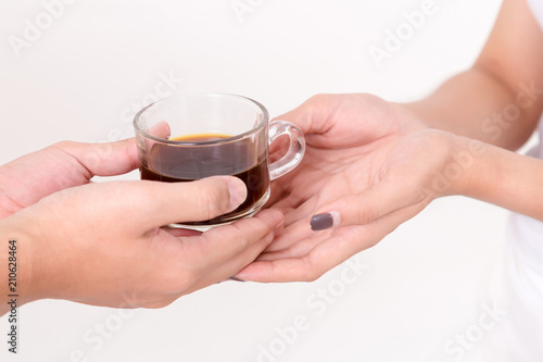 Close up of the arista giving cup of coffee to young asia woman Canvas Print