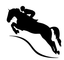 A Silhouette Of A Rider Jumpin...