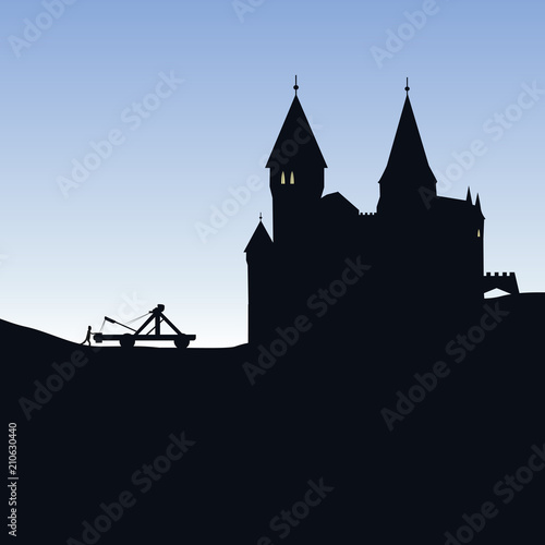 Fototapeta Simple medieval castle in silhouette with siege catapult