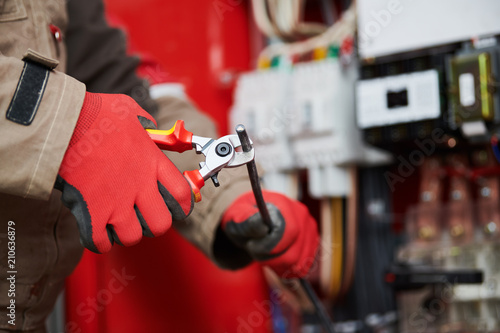 Electrician cutting cable with shear wire cutter Canvas Print