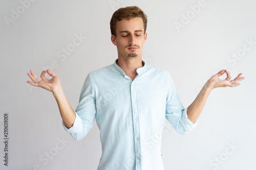 Fotografía Calm serene handsome guy in meditation mode