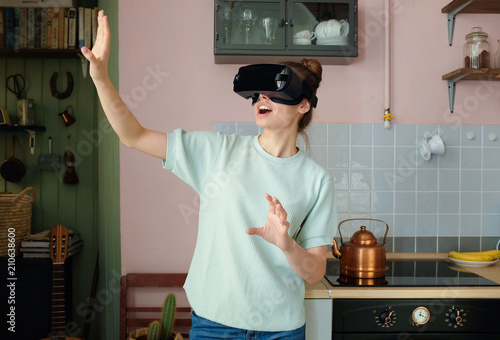 Young Pretty Woman Using Virtual Reality Glasses To Play Video Game
