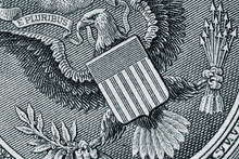 Dollar Bill Close Up Showing The Great Seal. The National Coat Of Arms Of The United States Of America