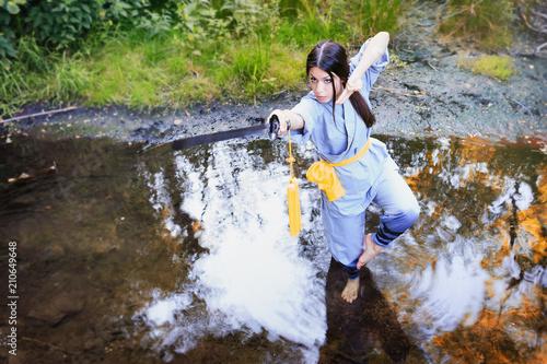 Fotografie, Obraz  Allenamento di Kung Fu nel fiume