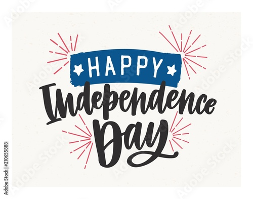 Fotografia Happy Independence Day lettering written with elegant cursive font and decorated with fireworks and tape