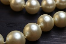 Necklace Made From Pearls On A Wooden Background