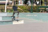 Skateboarder doing a skateboard trick in the skatepark.
