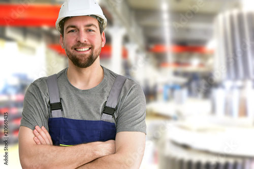 Fototapeta closeup Portrait of a friendly workmen in mechanical engineering //  freundliche