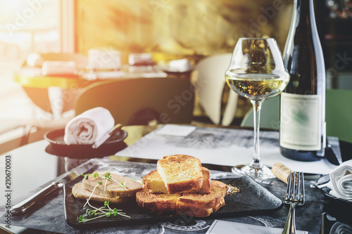 Staande foto Klaar gerecht Delicious dish with meat and toasts on the table in rays of the