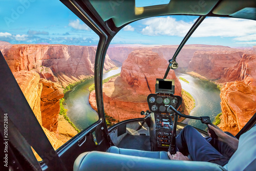 Helicopter cockpit scenic flight over Horseshoe Bend of Colorado River in Arizona, United States. Downstream from the Glen Canyon Dam and Lake Powell.