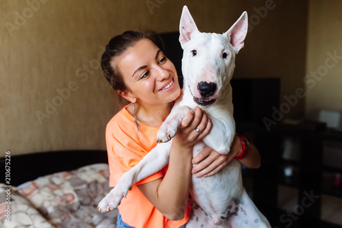 Cute girl petting her bull terrier Canvas Print