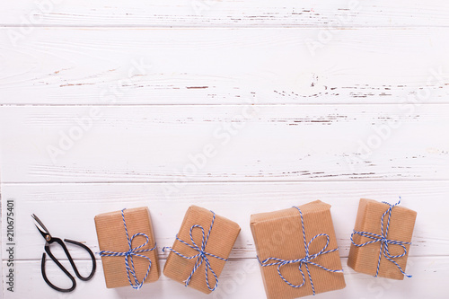 Wrapped gift boxes with presents on textured wooden background. Selective focus.