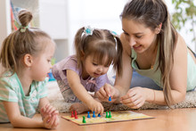 Mom And Her Children Playing I...