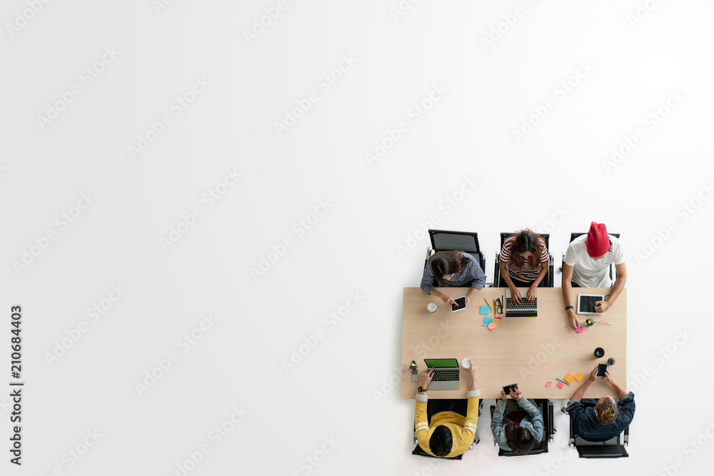 Fototapeta Top view of diverse people of creative team group using smartphone, tablet and computer laptop. Overhead of asian young creative start up meeting. Have copy space for fill text