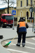 Worker Of Cleaning Company Sweeping, Cleaning City Street With B