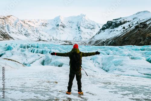 Poster Glaciers adventurous man walking on a glacier in iceland