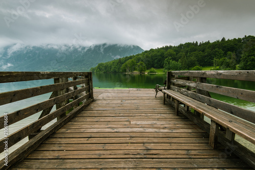 Canvas-taulu Wooden pier leading into Bohinj Lake, Slovenia