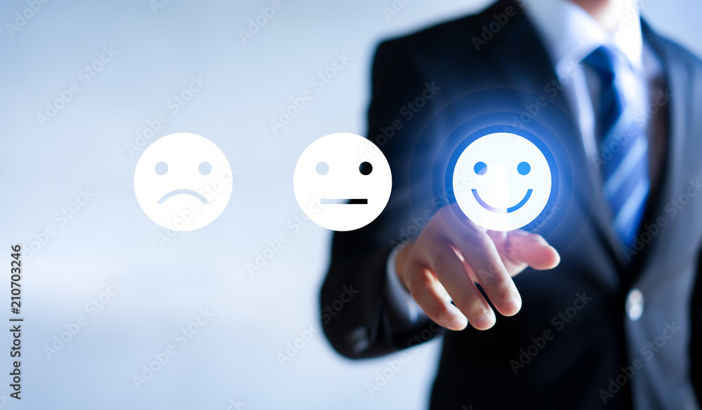 Fototapeta Businessman pressing happy icon, Customer service evaluation concept.