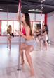 Women practicing pole dancing