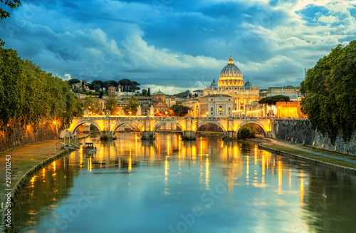 Poster Light pink Evening view of Basilica St Peter and bridge Sant Angelo in Vatican City Rome Italy. Rome architecture and landmark. St. Peter's cathedral in Rome.