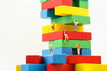 Miniature People : Climbing Colorful Wooden Block With Challenging Route On Cliff, Concept Of The Path To Purpose And Success.